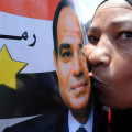 Egyptians celebrate after the inauguration of President al-Sisi